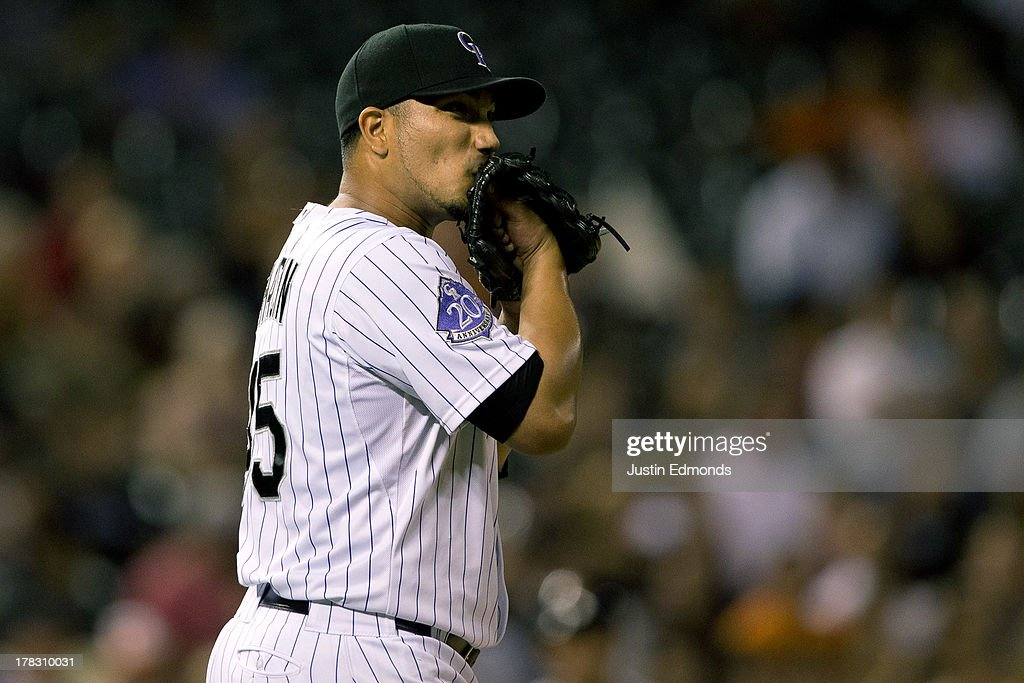 Starting pitcher Jhoulys Chacin of the Colorado Rockies reacts after his nohit bid was ended after six and twothirds innings of work by Brandon...