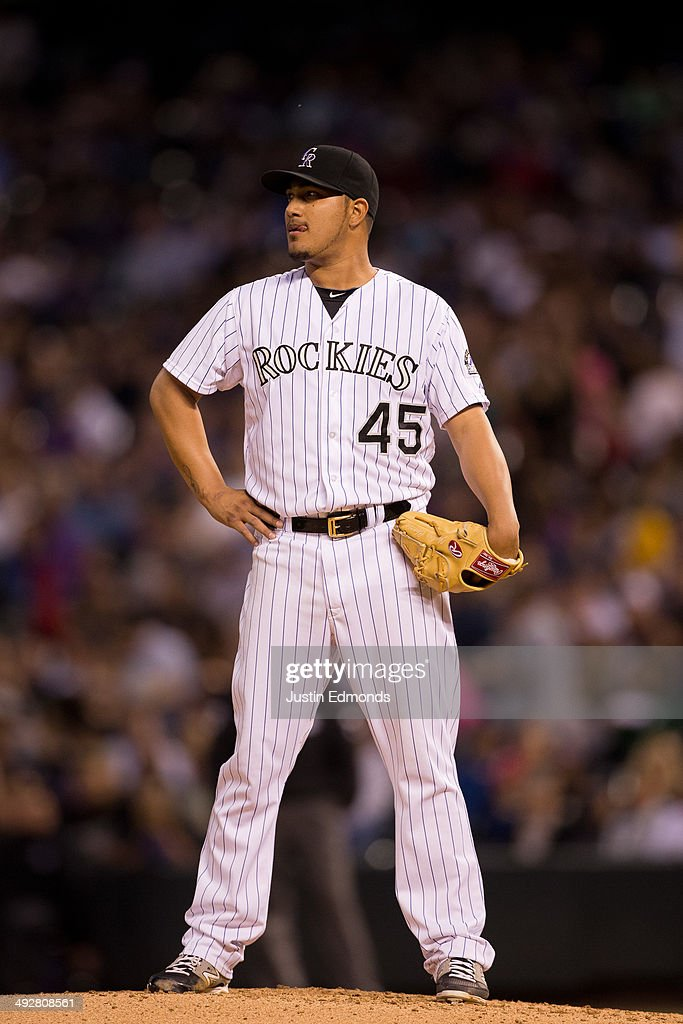 Starting pitcher Jhoulys Chacin of the Colorado Rockies stands on the mound in frustration moments before being pulled from the game during the sixth...