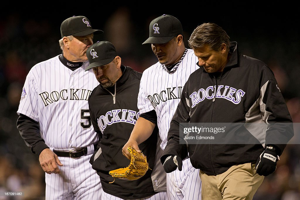 Starting pitcher <a gi-track='captionPersonalityLinkClicked' href=/galleries/search?phrase=Jhoulys+Chacin&family=editorial&specificpeople=5734320 ng-click='$event.stopPropagation()'>Jhoulys Chacin</a> #45 of the Colorado Rockies walks off the field under the watchful eye of pitching coach Jim Wright #52 , Manager <a gi-track='captionPersonalityLinkClicked' href=/galleries/search?phrase=Walt+Weiss&family=editorial&specificpeople=239045 ng-click='$event.stopPropagation()'>Walt Weiss</a> and the trainer during the seventh inning against the Arizona Diamondbacks at Coors Field on April 19, 2013 in Denver, Colorado. The Rockies defeated the Diamondbacks 3-1.