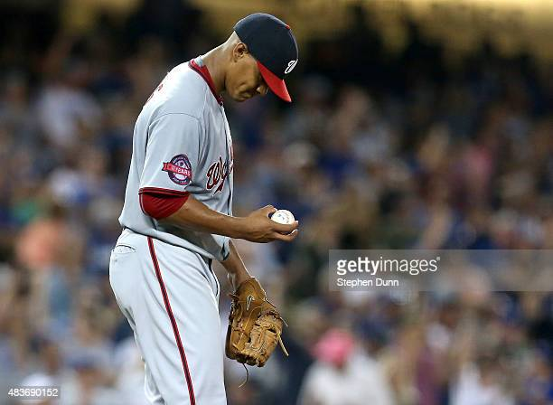 Starting pitcher Joe Ross of the Washington Nationals reacts after giving up a two run home run to Yasiel Puig of the Los Angeles Dodgers in the...