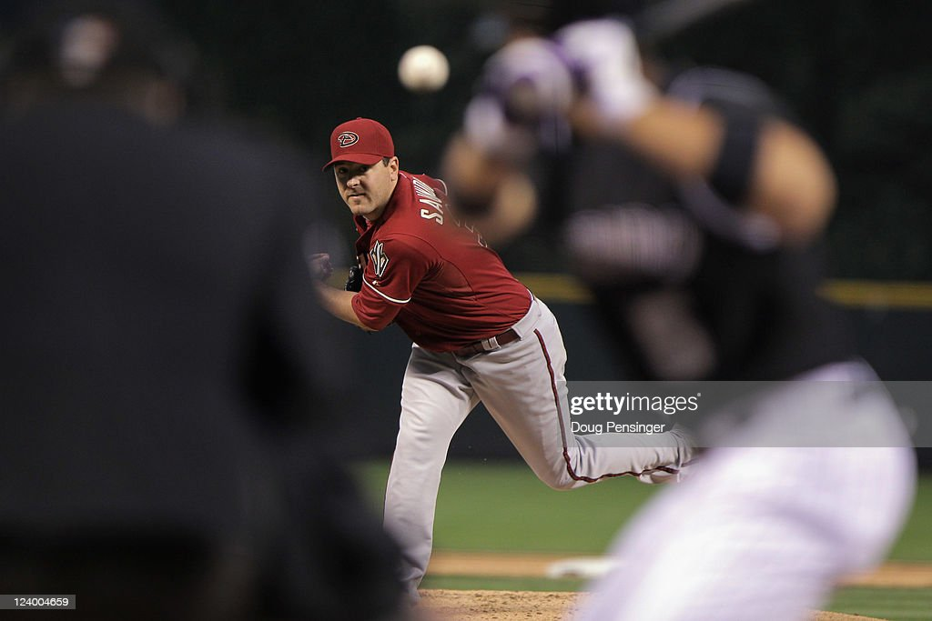 Starting pitcher Joe Saunders #34 of the Arizona Diamondbacks delivers against Carlos Gonzalez #5 of the Colorado Rockies at Coors Field on September 7, 2011 in Denver, Colorado.