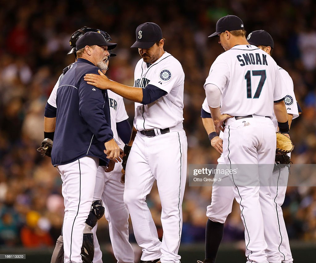 Starting pitcher <a gi-track='captionPersonalityLinkClicked' href=/galleries/search?phrase=Joe+Saunders&family=editorial&specificpeople=835979 ng-click='$event.stopPropagation()'>Joe Saunders</a> #23 of the Seattle Mariners gives manager <a gi-track='captionPersonalityLinkClicked' href=/galleries/search?phrase=Eric+Wedge&family=editorial&specificpeople=214257 ng-click='$event.stopPropagation()'>Eric Wedge</a> #22 a pat on the shoulder as he is removed from the game in the seventh inning against the Houston Astros on Opening Day at Safeco Field on April 8, 2013 in Seattle, Washington. The Mariners defeated the Astros 3-0.