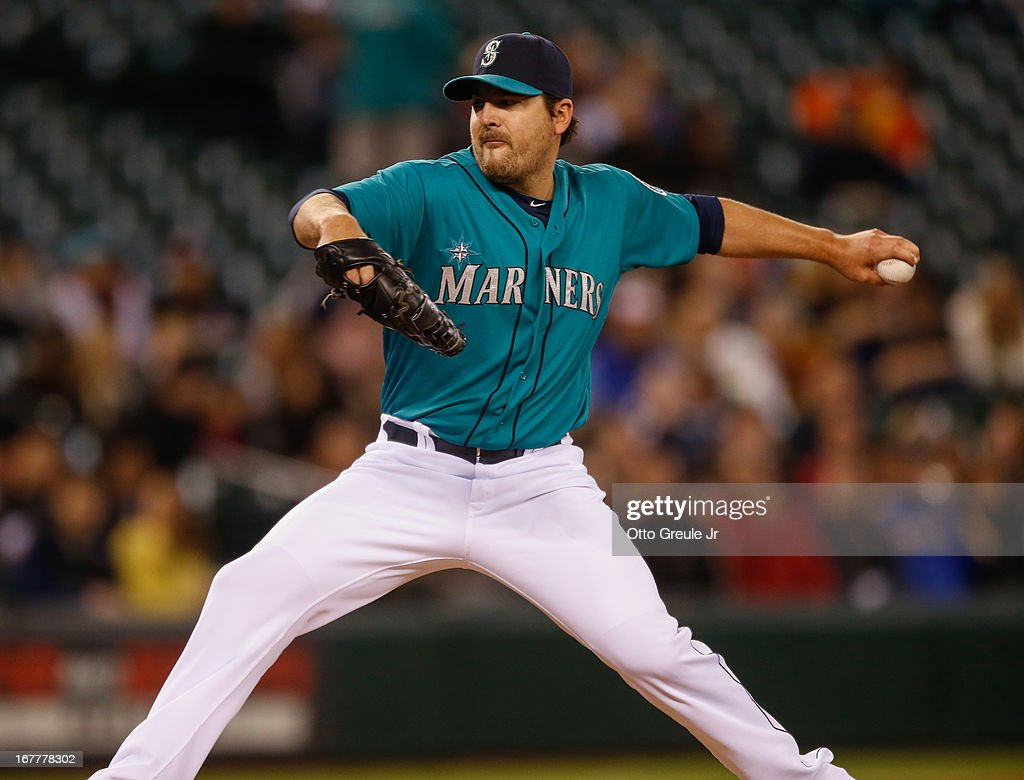 Starting pitcher <a gi-track='captionPersonalityLinkClicked' href=/galleries/search?phrase=Joe+Saunders&family=editorial&specificpeople=835979 ng-click='$event.stopPropagation()'>Joe Saunders</a> #23 of the Seattle Mariners pitches against the Baltimore Orioles at Safeco Field on April 29, 2013 in Seattle, Washington. The Mariners defeated the Orioles 6-2.