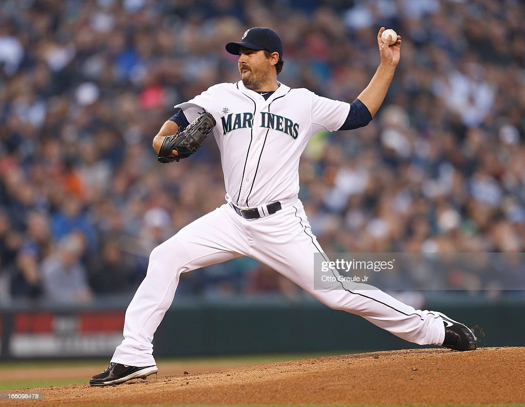 Starting pitcher <a gi-track='captionPersonalityLinkClicked' href=/galleries/search?phrase=Joe+Saunders&family=editorial&specificpeople=835979 ng-click='$event.stopPropagation()'>Joe Saunders</a> #23 of the Seattle Mariners pitches in the first inning against the Houston Astros on Opening Day at Safeco Field on April 8, 2013 in Seattle, Washington.