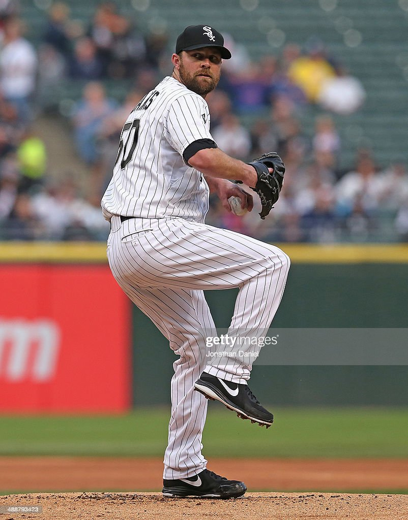 Starting pitcher <a gi-track='captionPersonalityLinkClicked' href=/galleries/search?phrase=John+Danks&family=editorial&specificpeople=835613 ng-click='$event.stopPropagation()'>John Danks</a> #50 of the Chicago White Sox delivers the ball against the Chicago Cubs at U.S. Cellular Field on May 7, 2014 in Chicago, Illinois.