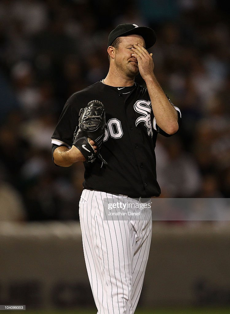 Starting pitcher <a gi-track='captionPersonalityLinkClicked' href=/galleries/search?phrase=John+Danks&family=editorial&specificpeople=835613 ng-click='$event.stopPropagation()'>John Danks</a> #50 of the Chicago White Sox reacts after giving up a run to the Minnesota Twins at U.S. Cellular Field on September 14, 2010 in Chicago, Illinois.