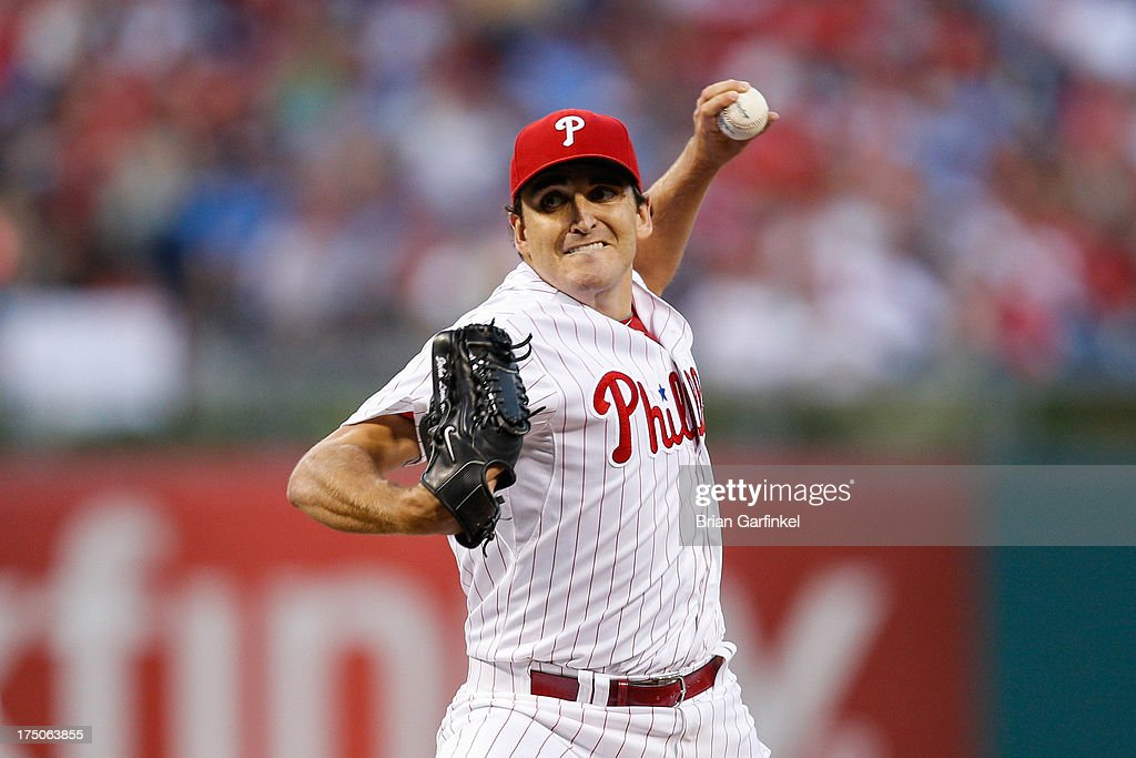 Starting pitcher <a gi-track='captionPersonalityLinkClicked' href=/galleries/search?phrase=John+Lannan&family=editorial&specificpeople=4432497 ng-click='$event.stopPropagation()'>John Lannan</a> #27 of the Philadelphia Phillies throws a pitch during the game against the San Francisco Giants at Citizens Bank Park on July 30, 2013 in Philadelphia, Pennsylvania.