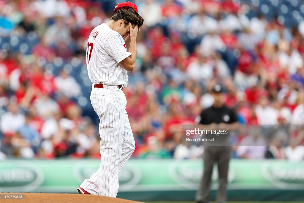 Starting pitcher <a gi-track='captionPersonalityLinkClicked' href=/galleries/search?phrase=John+Lannan&family=editorial&specificpeople=4432497 ng-click='$event.stopPropagation()'>John Lannan</a> #27 of the Philadelphia Phillies wipes his brow in the first inning of the game against the Washington Nationals at Citizens Bank Park on June 17, 2013 in Philadelphia, Pennsylvania.