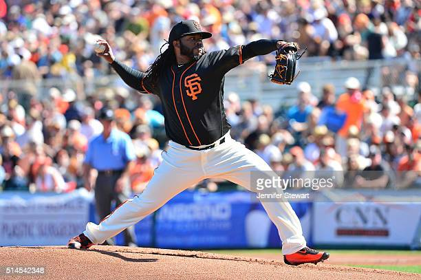 Starting pitcher Johnny Cueto of the San Francisco Giants delivers a pitch in the first inning against the Colorado Rockies during the spring...