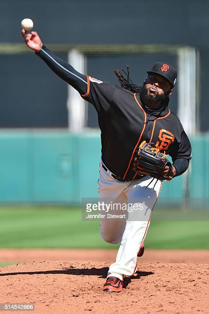 Starting pitcher Johnny Cueto of the San Francisco Giants delivers a pitch in the second inning against the Colorado Rockies during the spring...