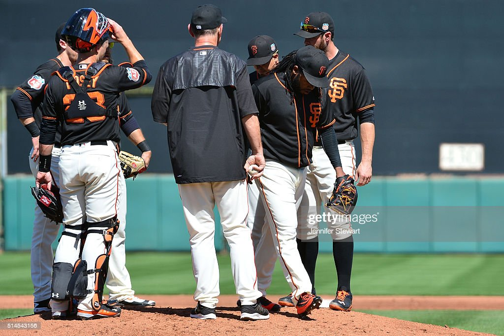 Starting pitcher Johnny Cueto #47 of the San Francisco Giants is removed from the game by manager Bruce Bochy #15 during the second inning of the spring training game at Scottsdale Stadium on March 9, 2016 in Scottsdale, Arizona.