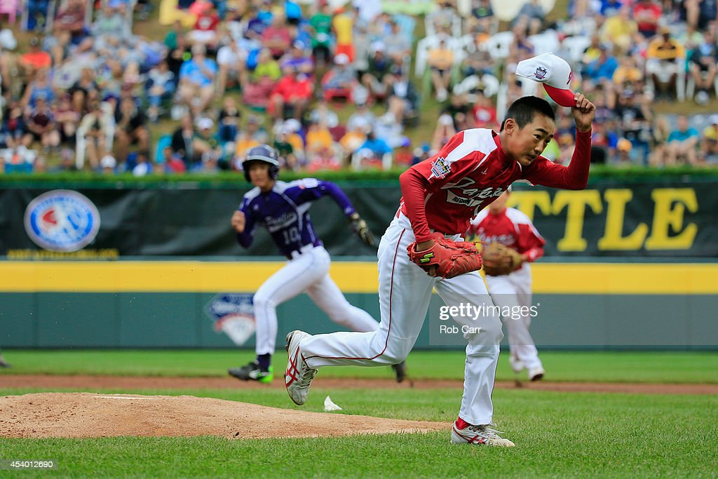 Starting pitcher Joichiro Fujimatsu #14 of Team Japan runs off the mound after getting the third out of the first inning against Team Asia-Pacific during the International Championship game of the Little League World Series at Lamade Stadium on August 23, 2014 in South Williamsport, Pennsylvania.