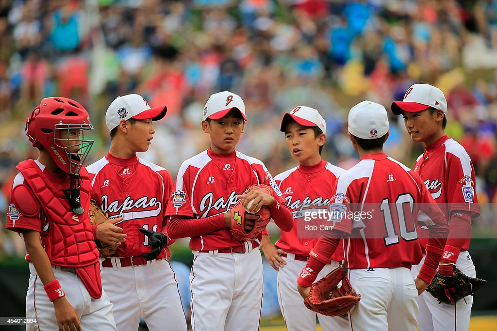 Starting pitcher Joichiro Fujimatsu #14 of Team Japan (C) talks with teammates during the first inning against Team Asia-Pacific in the International Championship game of the Little League World Series at Lamade Stadium on August 23, 2014 in South Williamsport, Pennsylvania.