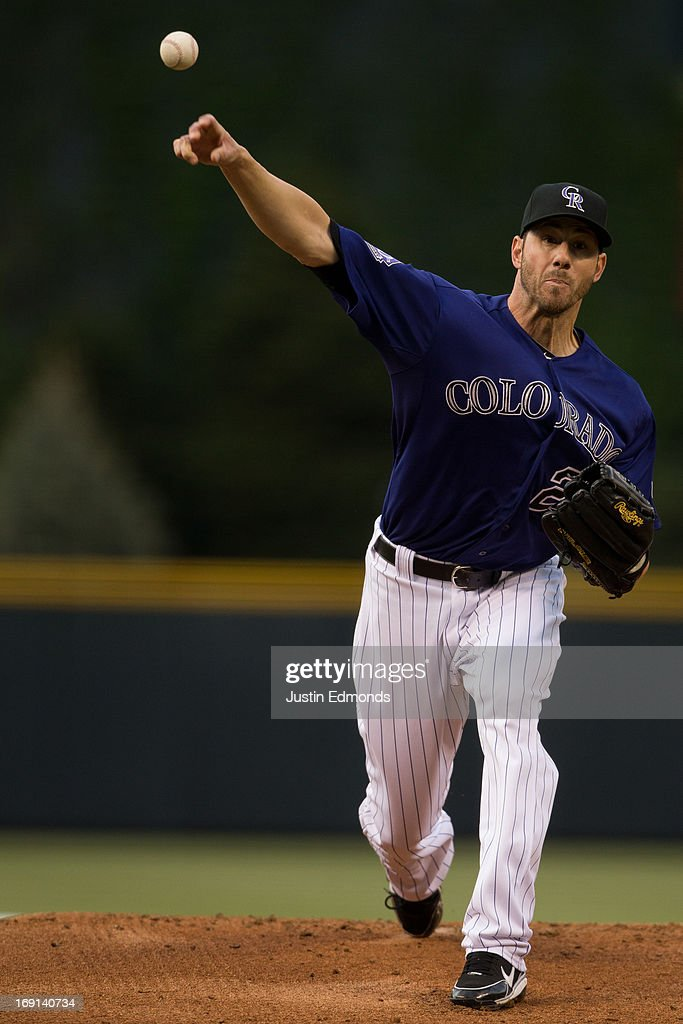 Starting pitcher <a gi-track='captionPersonalityLinkClicked' href=/galleries/search?phrase=Jon+Garland&family=editorial&specificpeople=209155 ng-click='$event.stopPropagation()'>Jon Garland</a> #27 of the Colorado Rockies delivers to home plate during the first inning against the Arizona Diamondbacks at Coors Field on May 20, 2013 in Denver, Colorado.