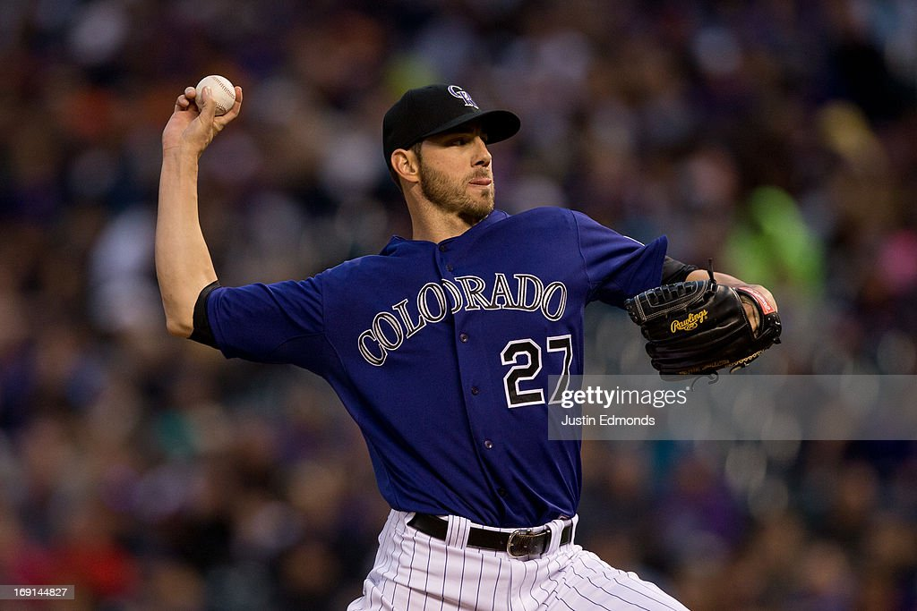 Starting pitcher <a gi-track='captionPersonalityLinkClicked' href=/galleries/search?phrase=Jon+Garland&family=editorial&specificpeople=209155 ng-click='$event.stopPropagation()'>Jon Garland</a> #27 of the Colorado Rockies delivers to home plate during the third inning against the Arizona Diamondbacks at Coors Field on May 20, 2013 in Denver, Colorado. The Diamondbacks defeated the Rockies 5-1.