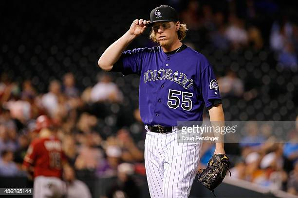 Starting pitcher Jon Gray of the Colorado Rockies heads to the dugout between innings against the Arizona Diamondbacks at Coors Field on September 2...