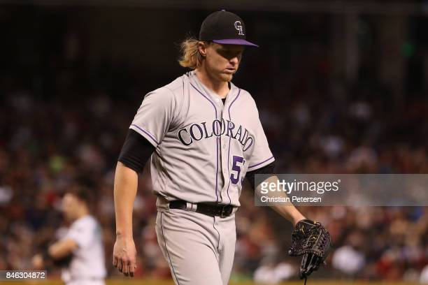 Starting pitcher Jon Gray of the Colorado Rockies walks off the field during the MLB game against the Arizona Diamondbacks at Chase Field on...