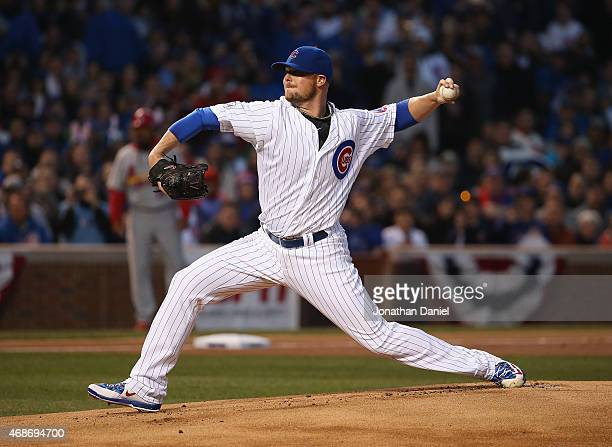 Starting pitcher Jon Lester of the Chicago Cubs delivers the first pitch of the 2015 season against the St Louis Cardinals during the Opening Night...