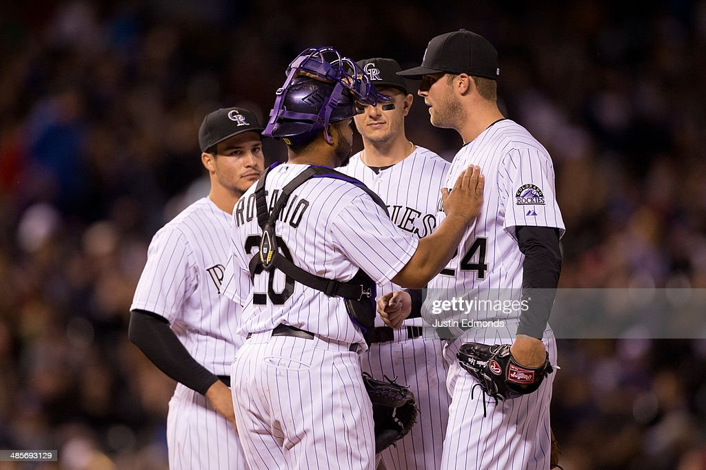 Starting pitcher <a gi-track='captionPersonalityLinkClicked' href=/galleries/search?phrase=Jordan+Lyles&family=editorial&specificpeople=7520081 ng-click='$event.stopPropagation()'>Jordan Lyles</a> #24 of the Colorado Rockies is congratulated on a solid outing of seven innings pitched by teammates <a gi-track='captionPersonalityLinkClicked' href=/galleries/search?phrase=Wilin+Rosario&family=editorial&specificpeople=5734314 ng-click='$event.stopPropagation()'>Wilin Rosario</a> #20, <a gi-track='captionPersonalityLinkClicked' href=/galleries/search?phrase=Nolan+Arenado&family=editorial&specificpeople=7934273 ng-click='$event.stopPropagation()'>Nolan Arenado</a> #28 and <a gi-track='captionPersonalityLinkClicked' href=/galleries/search?phrase=Troy+Tulowitzki&family=editorial&specificpeople=757353 ng-click='$event.stopPropagation()'>Troy Tulowitzki</a> #2 before being removed from the game during the eighth inning against the Colorado Rockies at Coors Field on April 19, 2014 in Denver, Colorado. The Rockies defeated the Phillies 3-1.