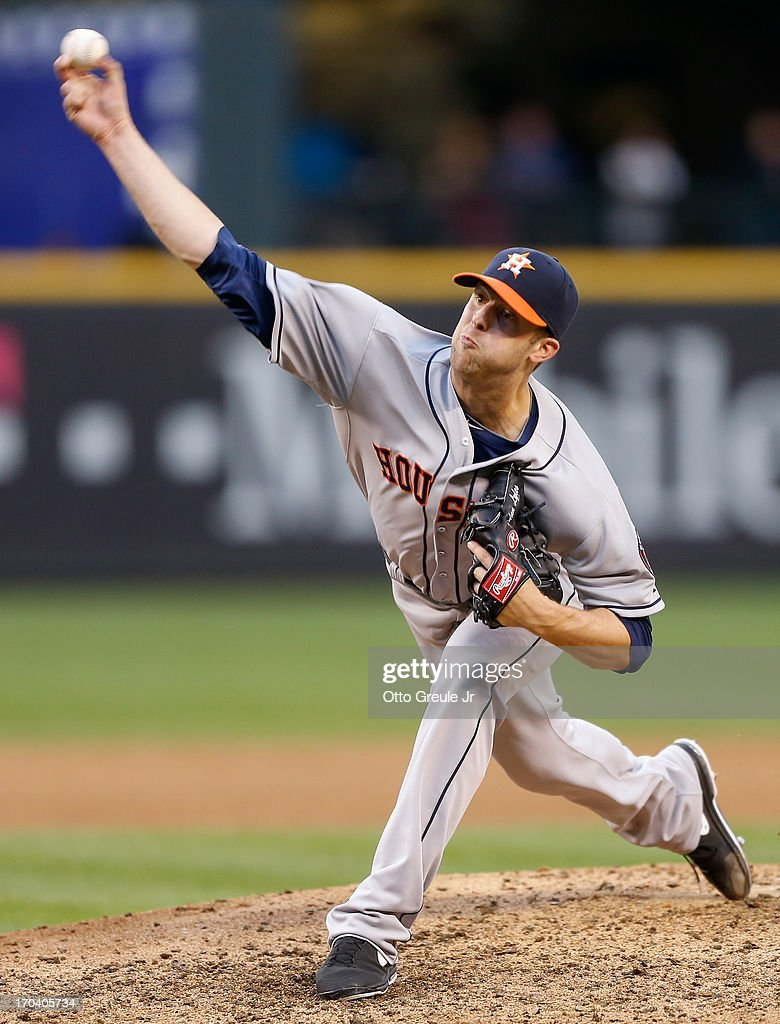 Starting pitcher <a gi-track='captionPersonalityLinkClicked' href=/galleries/search?phrase=Jordan+Lyles&family=editorial&specificpeople=7520081 ng-click='$event.stopPropagation()'>Jordan Lyles</a> #18 of the Houston Astros pitches against the Seattle Mariners at Safeco Field on June 12, 2013 in Seattle, Washington.