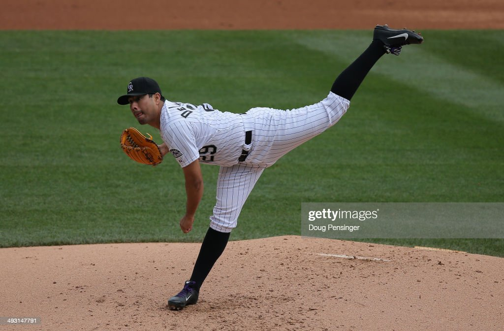 Starting pitcher <a gi-track='captionPersonalityLinkClicked' href=/galleries/search?phrase=Jorge+De+La+Rosa&family=editorial&specificpeople=244046 ng-click='$event.stopPropagation()'>Jorge De La Rosa</a> #29 of the Colorado Rockies delivers against the San Francisco Giants at Coors Field on May 22, 2014 in Denver, Colorado.