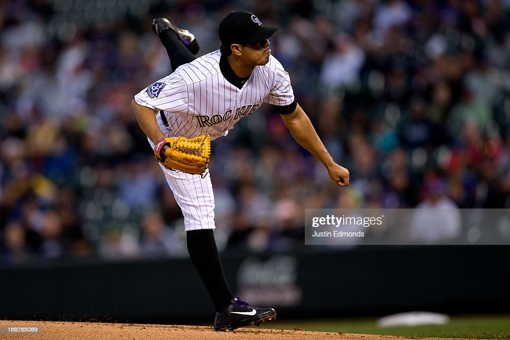 Starting pitcher <a gi-track='captionPersonalityLinkClicked' href=/galleries/search?phrase=Jorge+De+La+Rosa&family=editorial&specificpeople=244046 ng-click='$event.stopPropagation()'>Jorge De La Rosa</a> #29 of the Colorado Rockies delivers to home plate during the first inning against the New York Yankees at Coors Field on May 7, 2013 in Denver, Colorado.