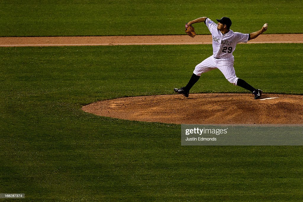 Starting pitcher <a gi-track='captionPersonalityLinkClicked' href=/galleries/search?phrase=Jorge+De+La+Rosa&family=editorial&specificpeople=244046 ng-click='$event.stopPropagation()'>Jorge De La Rosa</a> #29 of the Colorado Rockies delivers to home plate during the sixth inning against the New York Yankees at Coors Field on May 7, 2013 in Denver, Colorado. The Rockies defeated the Yankees 2-0.