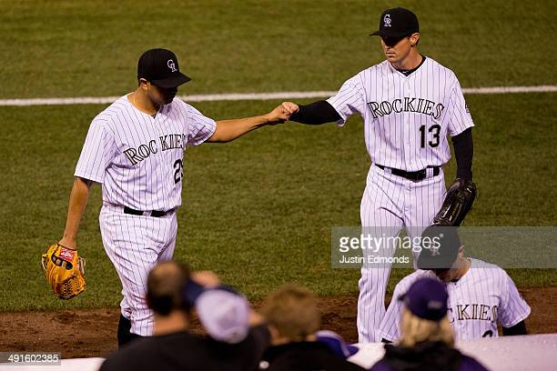 Starting pitcher Jorge De La Rosa of the Colorado Rockies is congratulated by Drew Stubbs after getting out of the seventh inning unscathed against...