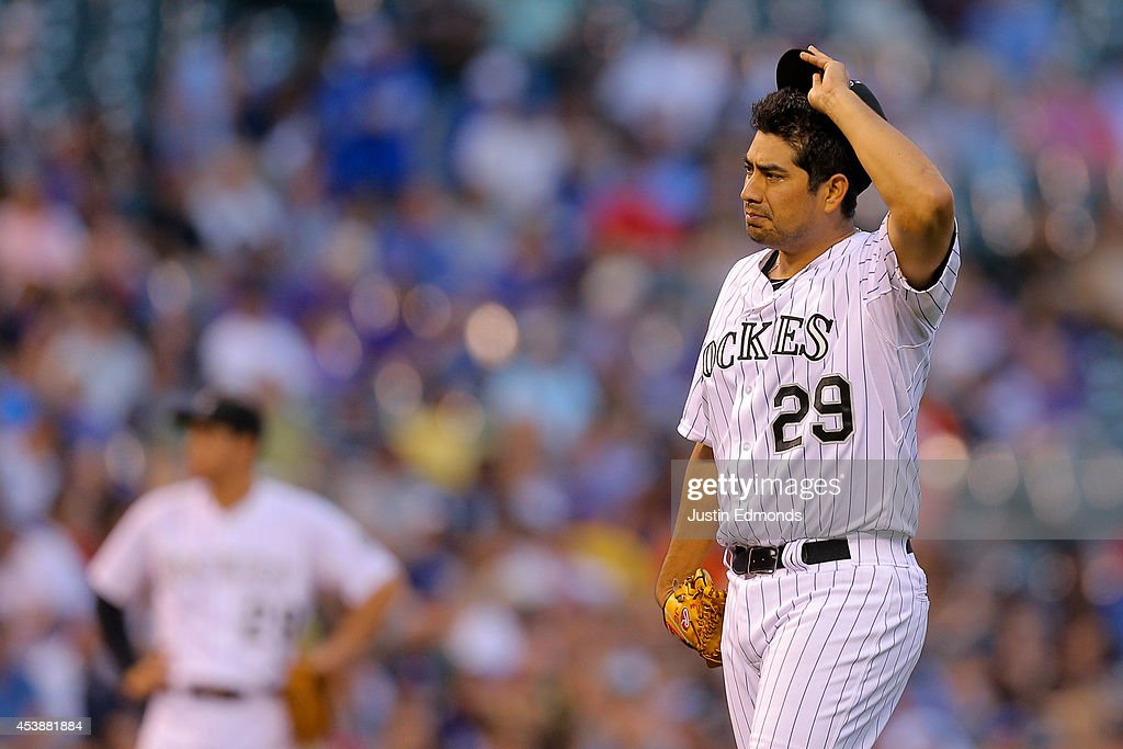Starting pitcher <a gi-track='captionPersonalityLinkClicked' href=/galleries/search?phrase=Jorge+De+La+Rosa&family=editorial&specificpeople=244046 ng-click='$event.stopPropagation()'>Jorge De La Rosa</a> #29 of the Colorado Rockies reacts after giving up a home run to <a gi-track='captionPersonalityLinkClicked' href=/galleries/search?phrase=Alex+Gordon+-+Baseball+Player&family=editorial&specificpeople=4494252 ng-click='$event.stopPropagation()'>Alex Gordon</a> (not pictured) of the Kansas City Royals during the second inning against the Kansas City Royals at Coors Field on August 20, 2014 in Denver, Colorado.