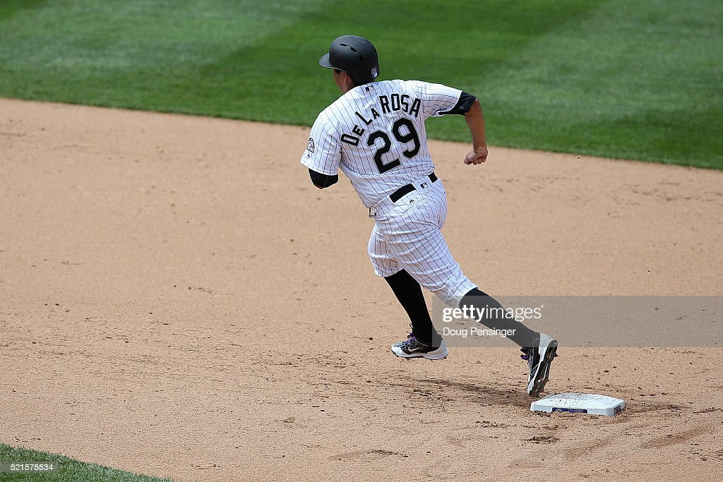 Starting pitcher Jorge De La Rosa #29 of the Colorado Rockies rounds second base against the San Francisco Giants at Coors Field on April 14, 2016 in Denver, Colorado. The Rockies defeated the Giants 11-6.
