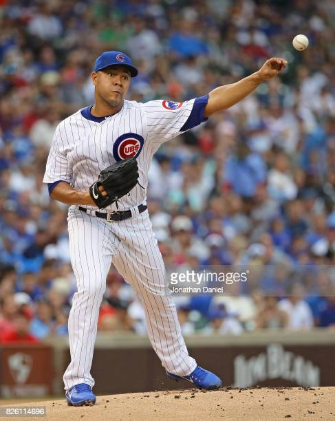 Starting pitcher Jose Quintana of the Chicago Cubs throws to first base against the Arizona Diamondbacks at Wrigley Field on August 3 2017 in Chicago...