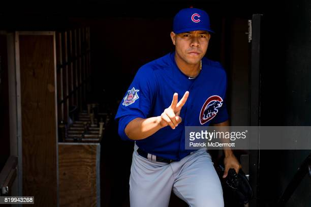 Starting pitcher Jose Quintana of the Chicago Cubs walks out of the clubhouse before playing a game against the Baltimore Orioles at Oriole Park at...