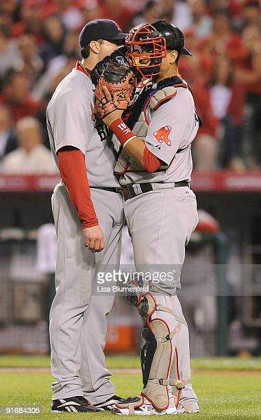Starting pitcher Josh Beckett of the Boston Red Sox and catcher Victor Martinez meet on the mound in the seventh inning of Game Two of the ALDS...