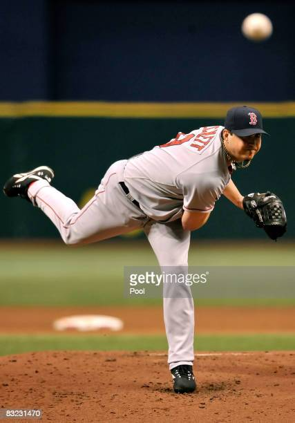 Starting pitcher Josh Beckett of the Boston Red Sox delivers a pitch in the first inning of game two of the American League Championship Series...