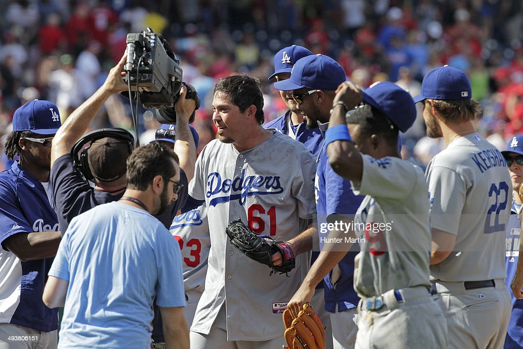 Starting pitcher <a gi-track='captionPersonalityLinkClicked' href=/galleries/search?phrase=Josh+Beckett&family=editorial&specificpeople=206314 ng-click='$event.stopPropagation()'>Josh Beckett</a> #61 of the Los Angeles Dodgers celebrates with teammates after throwing a no hitter during a game against the Philadelphia Phillies at Citizens Bank Park on May 25, 2014 in Philadelphia, Pennsylvania. The Dodgers won 6-0.