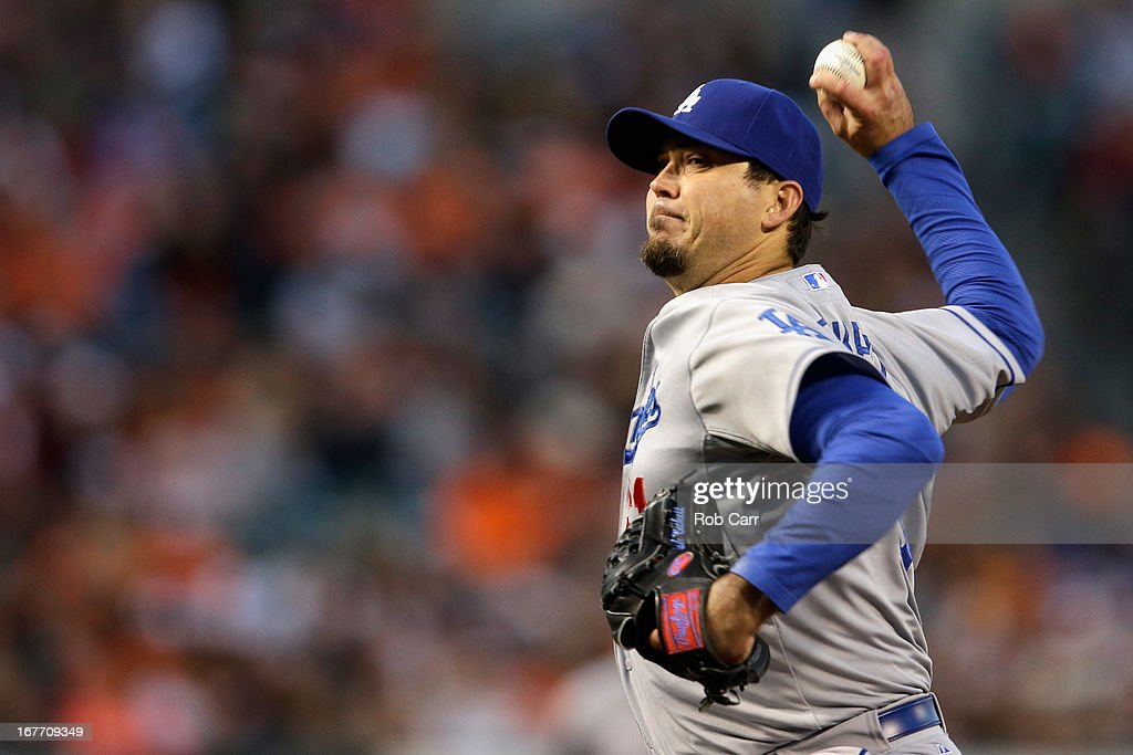 Starting pitcher <a gi-track='captionPersonalityLinkClicked' href=/galleries/search?phrase=Josh+Beckett&family=editorial&specificpeople=206314 ng-click='$event.stopPropagation()'>Josh Beckett</a> #61 of the Los Angeles Dodgers throws to a Baltimore Orioles batter in the second inning of game two of a double header at Oriole Park at Camden Yards on April 20, 2013 in Baltimore, Maryland.