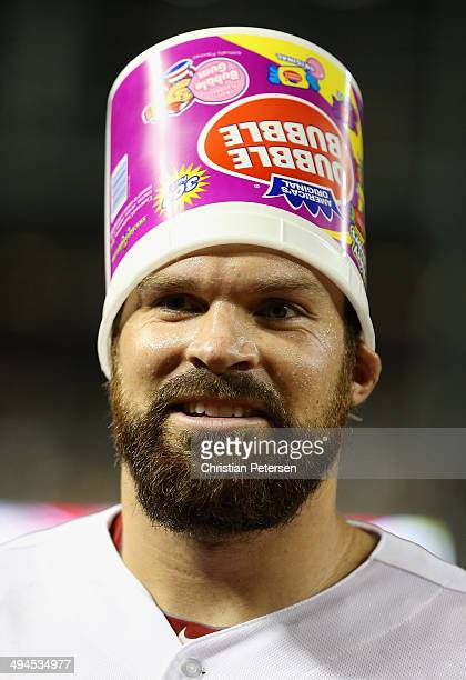 Starting pitcher Josh Collmenter of the Arizona Diamondbacks has bubble gum dumped over his head after defeating the Cincinnati Reds 40 in the MLB...