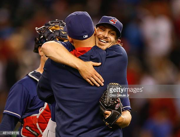 Starting pitcher Josh Tomlin of the Cleveland Indians is congratulated by a teammate after throwing a complete game 50 shutout against the Seattle...