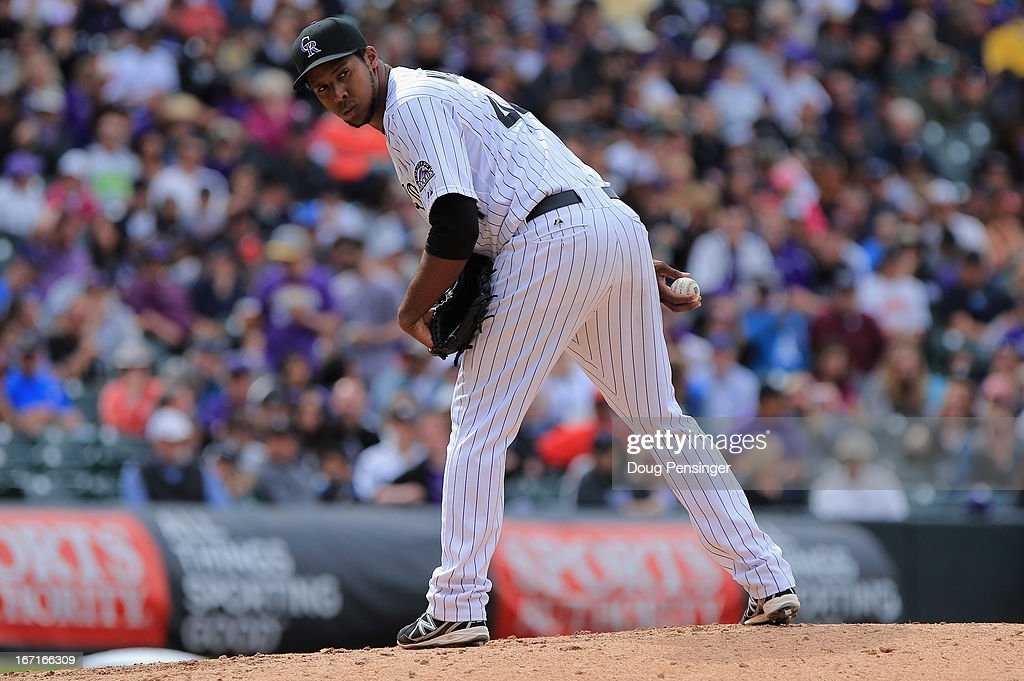 Starting pitcher Juan Nicasio #44 of the Colorado Rockies delivers against the Arizona Diamondbacks at Coors Field on April 21, 2013 in Denver, Colorado.