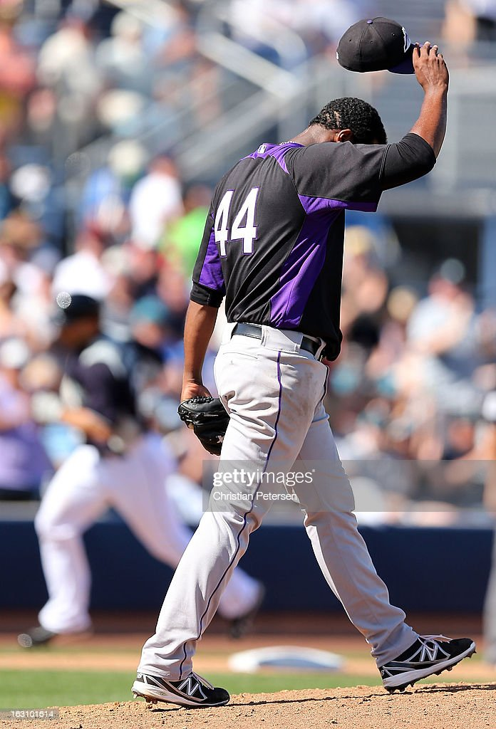 Starting pitcher <a gi-track='captionPersonalityLinkClicked' href=/galleries/search?phrase=Juan+Nicasio&family=editorial&specificpeople=6889135 ng-click='$event.stopPropagation()'>Juan Nicasio</a> #44 of the Colorado Rockies reacts after giving up a solo home run to <a gi-track='captionPersonalityLinkClicked' href=/galleries/search?phrase=Raul+Ibanez&family=editorial&specificpeople=206118 ng-click='$event.stopPropagation()'>Raul Ibanez</a> #28 of the Seattle Mariners during the third inning of the spring training game at Peoria Stadium on March 4, 2013 in Peoria, Arizona.