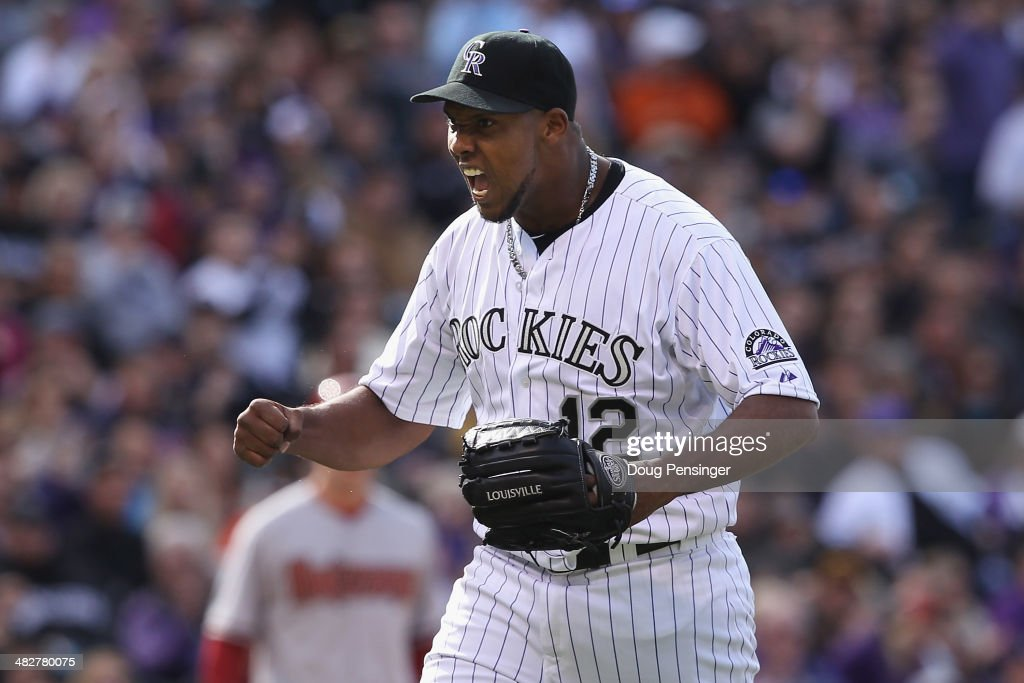 Starting pitcher Juan Nicasio #12 of the Colorado Rockies reacts to a defensive play by second baseman DJ LeMahieu #9 of the Colorado Rockies to end the top of the sixth inning against the Arizona Diamondbacks during the home opener at Coors Field on April 4, 2014 in Denver, Colorado.