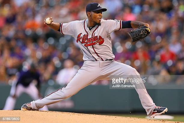 Starting pitcher Julio Teheran of the Atlanta Braves delivers to home plate during the first inning against the Colorado Rockies at Coors Field on...