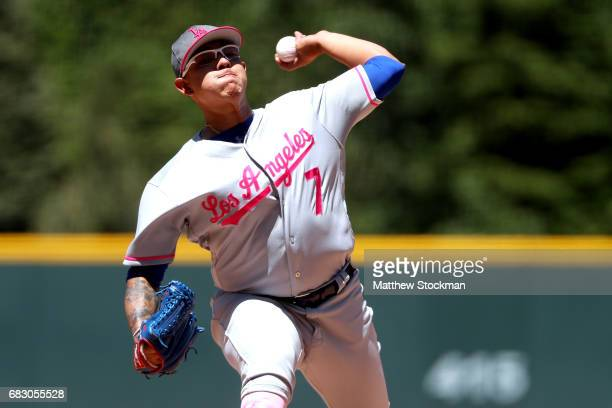 Starting pitcher Julio Urias of the Los Angeles Dodgers throws in the first inning against the Colorado Rockies at Coors Field on May 14 2017 in...