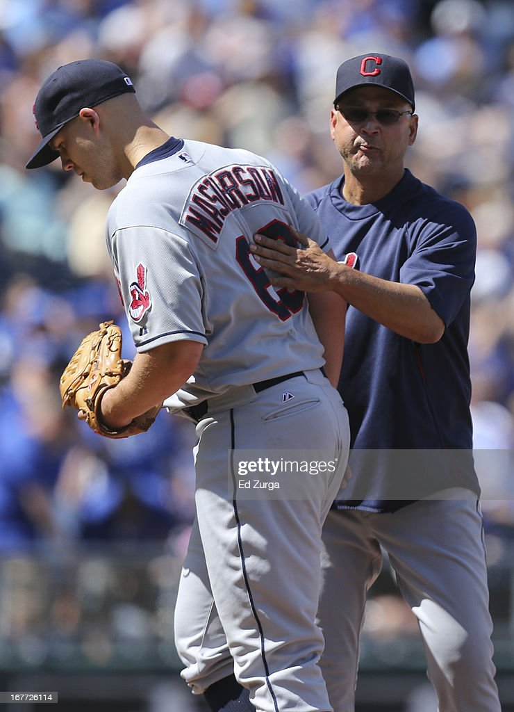 Starting pitcher <a gi-track='captionPersonalityLinkClicked' href=/galleries/search?phrase=Justin+Masterson&family=editorial&specificpeople=4950538 ng-click='$event.stopPropagation()'>Justin Masterson</a> #63 of the Cleveland Indians gets a pat on the back from manager <a gi-track='captionPersonalityLinkClicked' href=/galleries/search?phrase=Terry+Francona&family=editorial&specificpeople=171936 ng-click='$event.stopPropagation()'>Terry Francona</a> as he leaves a game in the seventh inning during game one of a doubleheader against the Kansas City Royals at Kauffman Stadium on April 28, 2013 in Kansas City, Missouri.