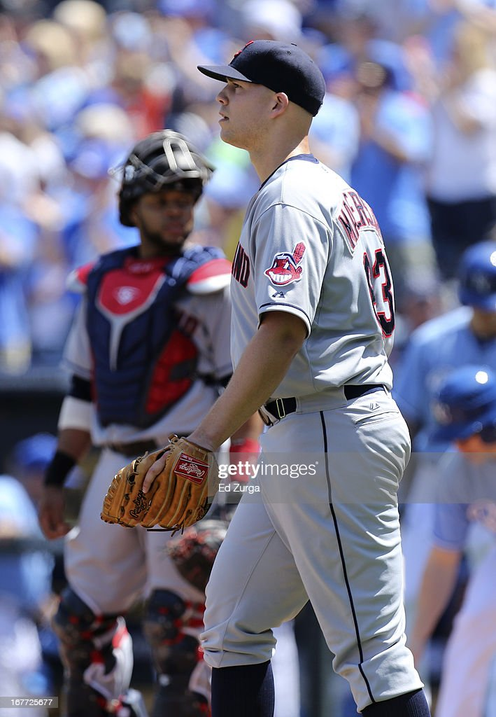 Starting pitcher <a gi-track='captionPersonalityLinkClicked' href=/galleries/search?phrase=Justin+Masterson&family=editorial&specificpeople=4950538 ng-click='$event.stopPropagation()'>Justin Masterson</a> #63 of the Cleveland Indians walks back to the mound after giving up a RBI single to Jarrod Dyson of the Kansas City Royals in the fourth inning during game one of a doubleheader at Kauffman Stadium on April 28, 2013 in Kansas City, Missouri.