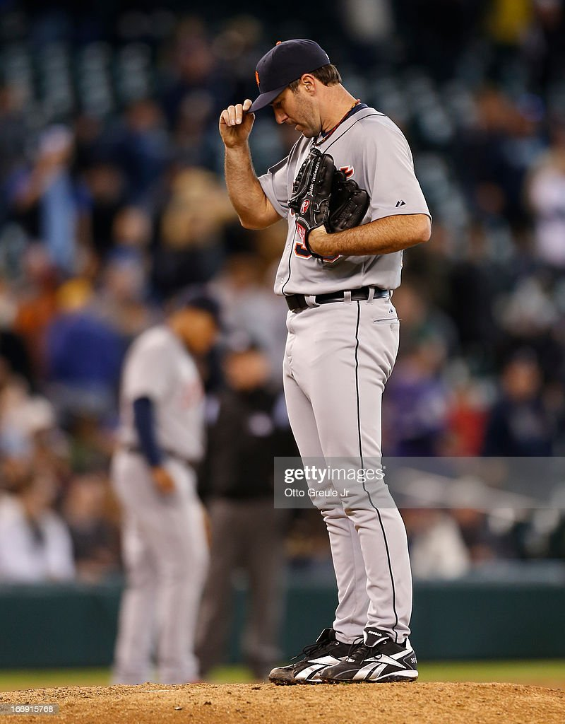 Starting pitcher <a gi-track='captionPersonalityLinkClicked' href=/galleries/search?phrase=Justin+Verlander&family=editorial&specificpeople=556723 ng-click='$event.stopPropagation()'>Justin Verlander</a> #35 of the Detroit Tigers adjusts his cap after falling behind 2-0 in the seventh inning against the Seattle Mariners at Safeco Field on April 18, 2013 in Seattle, Washington.