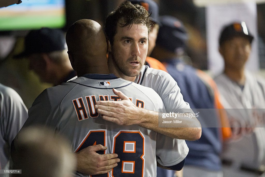Starting pitcher <a gi-track='captionPersonalityLinkClicked' href=/galleries/search?phrase=Justin+Verlander&family=editorial&specificpeople=556723 ng-click='$event.stopPropagation()'>Justin Verlander</a> #35 of the Detroit Tigers celebrates with <a gi-track='captionPersonalityLinkClicked' href=/galleries/search?phrase=Torii+Hunter&family=editorial&specificpeople=183408 ng-click='$event.stopPropagation()'>Torii Hunter</a> #48 during the eighth inning against the Cleveland Indians at Progressive Field on August 6, 2013 in Cleveland, Ohio. The Tigers defeated the Indians 5-1.