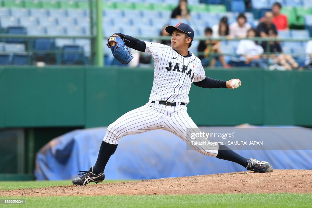Starting Pitcher Katsuki Azuma #21 of Japan pitches against Mexico during the Baseball Group B match between Japan and Mexico during the Universiade Taipei at the Xinzhuang Baseball Stadium on August 22, 2017 in Taipei, Taiwan.