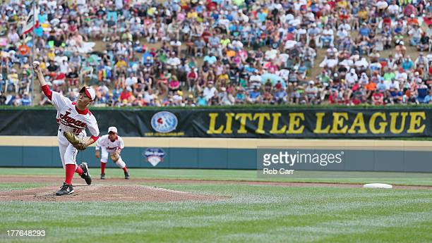 Starting pitcher Kazuki Ishida of the Tokyo Japan team throws to a batter from the West team from Chula Vista Ca during the first inning of the...
