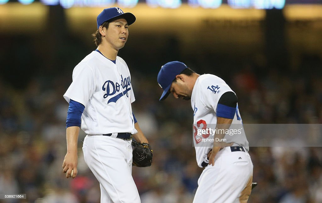 Starting pitcher Kenta Maeda and first baseman Adrian Gonzalez of the Los Angeles Dodgers react after giving up the first run of the game in the...